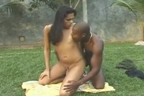 Exotic brunette tranny Does Interracial With muscular dark guy banging booty